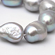 Hebras de perlas ovaladas de agua dulce cultivadas naturalesPEAR-R015-28-3